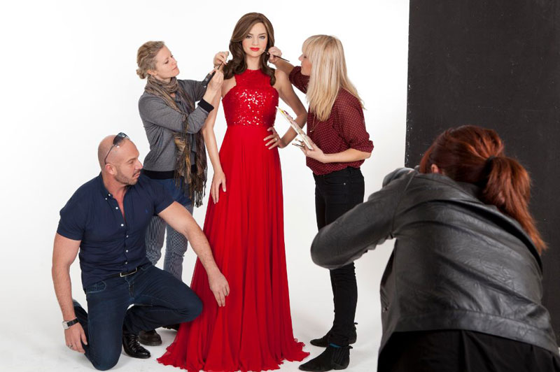Miranda Kerr gets waxed by Madame Tussauds Sydney wearing Alex Perry